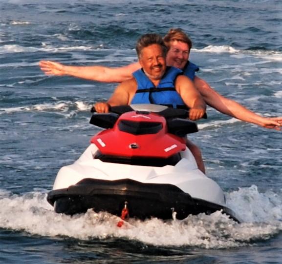 Neil and Sue riding a jetski